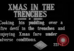 Image of British soldiers sharing Christmas pudding in trenches France, 1916, second 2 stock footage video 65675042463