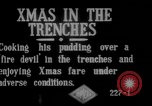 Image of British soldiers sharing Christmas pudding in trenches France, 1916, second 3 stock footage video 65675042463