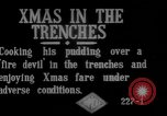 Image of British soldiers sharing Christmas pudding in trenches France, 1916, second 4 stock footage video 65675042463