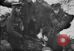 Image of British soldiers sharing Christmas pudding in trenches France, 1916, second 9 stock footage video 65675042463