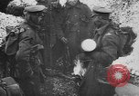 Image of British soldiers sharing Christmas pudding in trenches France, 1916, second 11 stock footage video 65675042463
