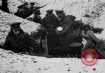 Image of British soldiers sharing Christmas pudding in trenches France, 1916, second 13 stock footage video 65675042463