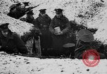 Image of British soldiers sharing Christmas pudding in trenches France, 1916, second 14 stock footage video 65675042463