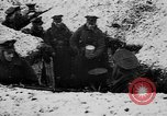 Image of British soldiers sharing Christmas pudding in trenches France, 1916, second 15 stock footage video 65675042463