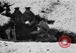 Image of British soldiers sharing Christmas pudding in trenches France, 1916, second 17 stock footage video 65675042463