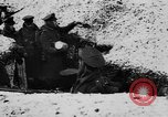 Image of British soldiers sharing Christmas pudding in trenches France, 1916, second 18 stock footage video 65675042463
