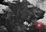 Image of British soldiers sharing Christmas pudding in trenches France, 1916, second 20 stock footage video 65675042463