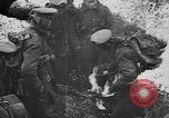 Image of British soldiers sharing Christmas pudding in trenches France, 1916, second 21 stock footage video 65675042463