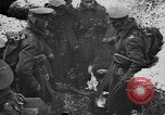 Image of British soldiers sharing Christmas pudding in trenches France, 1916, second 22 stock footage video 65675042463