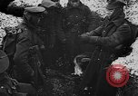Image of British soldiers sharing Christmas pudding in trenches France, 1916, second 23 stock footage video 65675042463