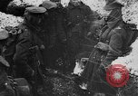 Image of British soldiers sharing Christmas pudding in trenches France, 1916, second 24 stock footage video 65675042463