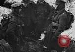 Image of British soldiers sharing Christmas pudding in trenches France, 1916, second 25 stock footage video 65675042463