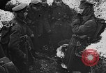 Image of British soldiers sharing Christmas pudding in trenches France, 1916, second 26 stock footage video 65675042463