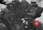 Image of British soldiers sharing Christmas pudding in trenches France, 1916, second 27 stock footage video 65675042463