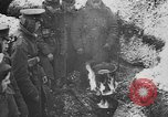 Image of British soldiers sharing Christmas pudding in trenches France, 1916, second 28 stock footage video 65675042463