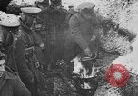 Image of British soldiers sharing Christmas pudding in trenches France, 1916, second 29 stock footage video 65675042463
