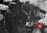 Image of British soldiers sharing Christmas pudding in trenches France, 1916, second 31 stock footage video 65675042463
