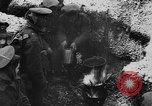 Image of British soldiers sharing Christmas pudding in trenches France, 1916, second 32 stock footage video 65675042463