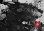 Image of British soldiers sharing Christmas pudding in trenches France, 1916, second 33 stock footage video 65675042463