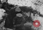 Image of British soldiers sharing Christmas pudding in trenches France, 1916, second 34 stock footage video 65675042463