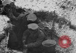 Image of British soldiers sharing Christmas pudding in trenches France, 1916, second 35 stock footage video 65675042463