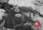 Image of British soldiers sharing Christmas pudding in trenches France, 1916, second 36 stock footage video 65675042463