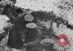 Image of British soldiers sharing Christmas pudding in trenches France, 1916, second 37 stock footage video 65675042463