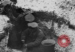 Image of British soldiers sharing Christmas pudding in trenches France, 1916, second 38 stock footage video 65675042463