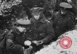 Image of British soldiers sharing Christmas pudding in trenches France, 1916, second 39 stock footage video 65675042463