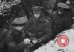 Image of British soldiers sharing Christmas pudding in trenches France, 1916, second 40 stock footage video 65675042463