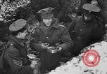 Image of British soldiers sharing Christmas pudding in trenches France, 1916, second 41 stock footage video 65675042463