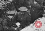Image of British soldiers sharing Christmas pudding in trenches France, 1916, second 43 stock footage video 65675042463
