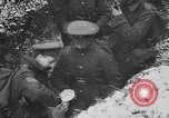 Image of British soldiers sharing Christmas pudding in trenches France, 1916, second 44 stock footage video 65675042463