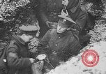 Image of British soldiers sharing Christmas pudding in trenches France, 1916, second 45 stock footage video 65675042463