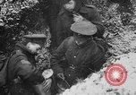 Image of British soldiers sharing Christmas pudding in trenches France, 1916, second 46 stock footage video 65675042463