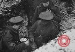 Image of British soldiers sharing Christmas pudding in trenches France, 1916, second 49 stock footage video 65675042463