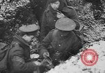 Image of British soldiers sharing Christmas pudding in trenches France, 1916, second 50 stock footage video 65675042463
