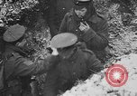 Image of British soldiers sharing Christmas pudding in trenches France, 1916, second 51 stock footage video 65675042463