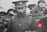 Image of British soldiers sharing Christmas pudding in trenches France, 1916, second 55 stock footage video 65675042463