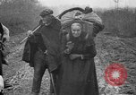 Image of French refugees with American soldiers in World War I France, 1918, second 31 stock footage video 65675042495