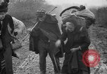 Image of French refugees with American soldiers in World War I France, 1918, second 39 stock footage video 65675042495