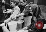 Image of distributing food Ruhr Germany, 1923, second 14 stock footage video 65675042504
