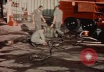 Image of American airmen in firehouse at airbase Takhli Thailand, 1964, second 2 stock footage video 65675042581