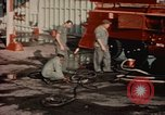 Image of American airmen in firehouse at airbase Takhli Thailand, 1964, second 8 stock footage video 65675042581