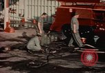 Image of American airmen in firehouse at airbase Takhli Thailand, 1964, second 9 stock footage video 65675042581