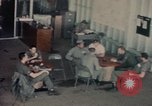 Image of American airmen in firehouse at airbase Takhli Thailand, 1964, second 16 stock footage video 65675042581