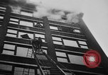 Image of building on fire Chicago Illinois USA, 1930, second 42 stock footage video 65675042807