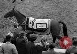 Image of Grand National horse race Liverpool England United Kingdom, 1963, second 15 stock footage video 65675042828