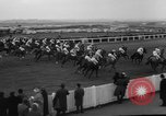 Image of Grand National horse race Liverpool England United Kingdom, 1963, second 30 stock footage video 65675042828
