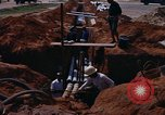 Image of laying pipes Thailand, 1966, second 8 stock footage video 65675042838